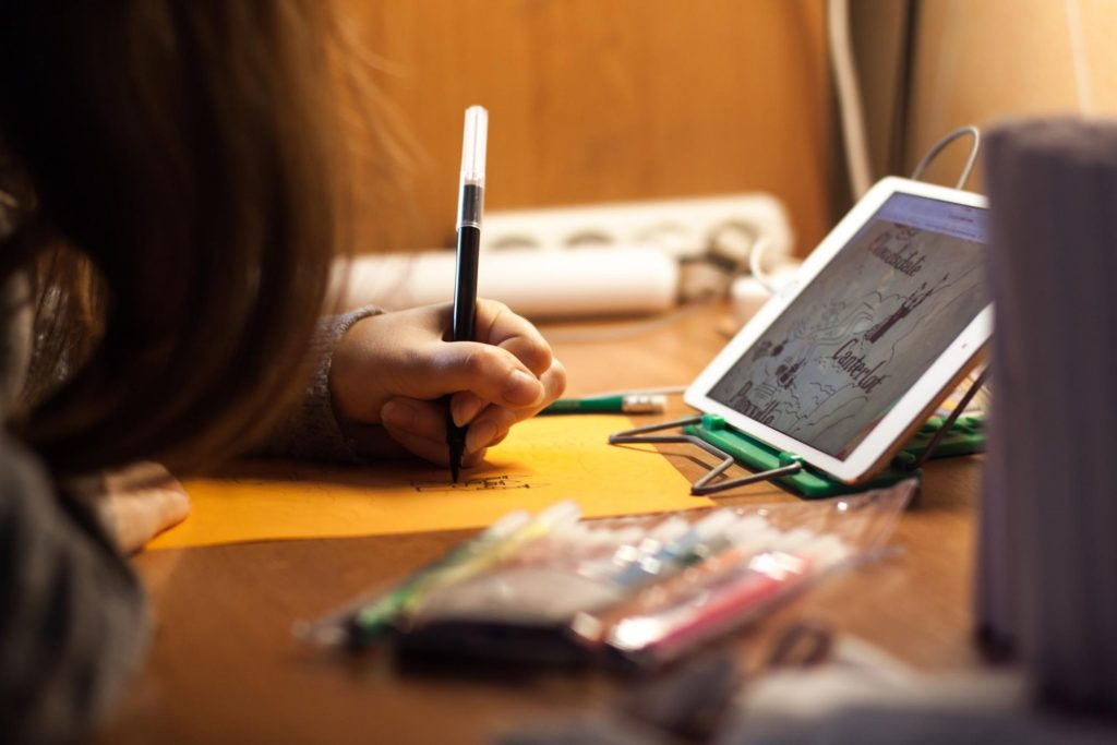 child using technology for creativity