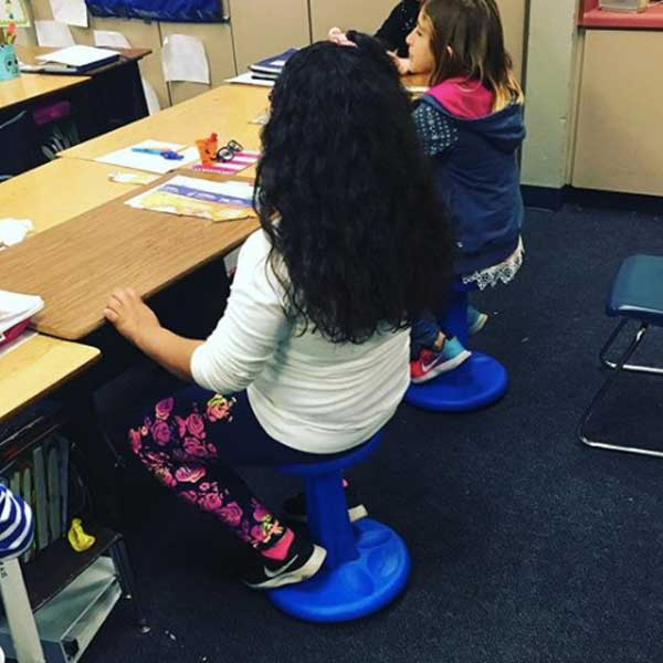 girl-using-wobble-stool-at-school