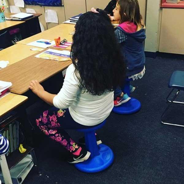 girl-using-wobble-stool-at-school