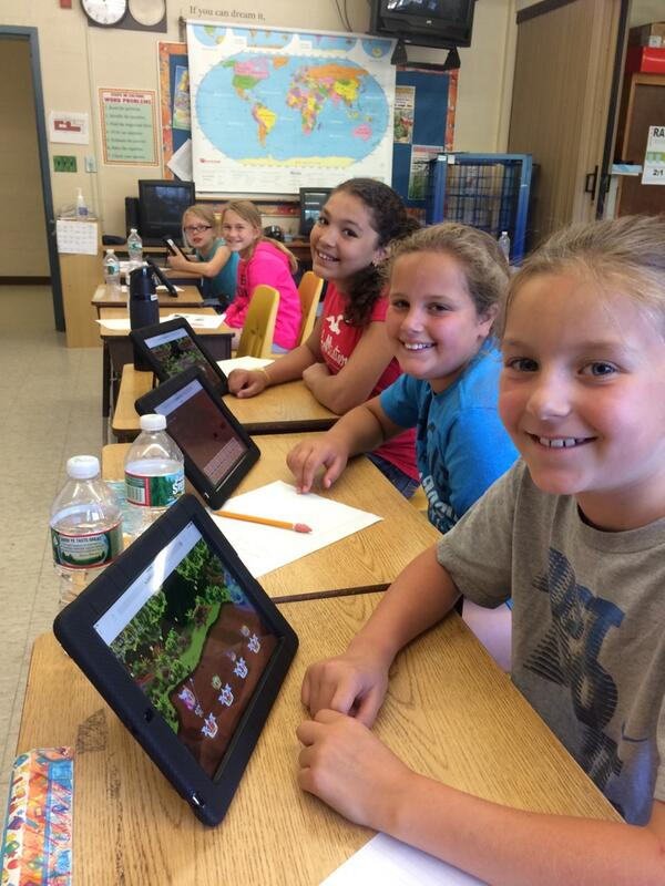 A group of students play Prodigy, an educational math video game, on their tablets at school.