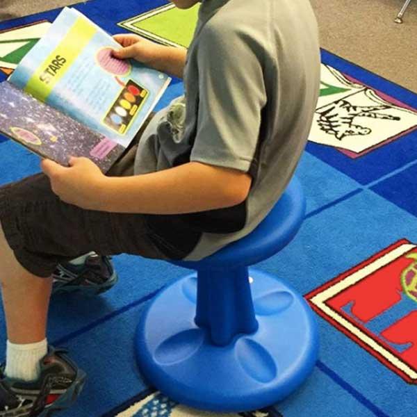 student-reading-on-wobble-stool