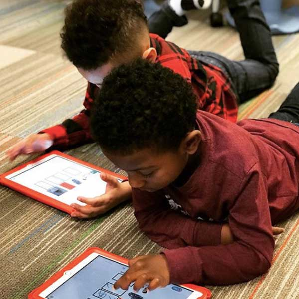 students-studying-using-tablets-on-the-floor