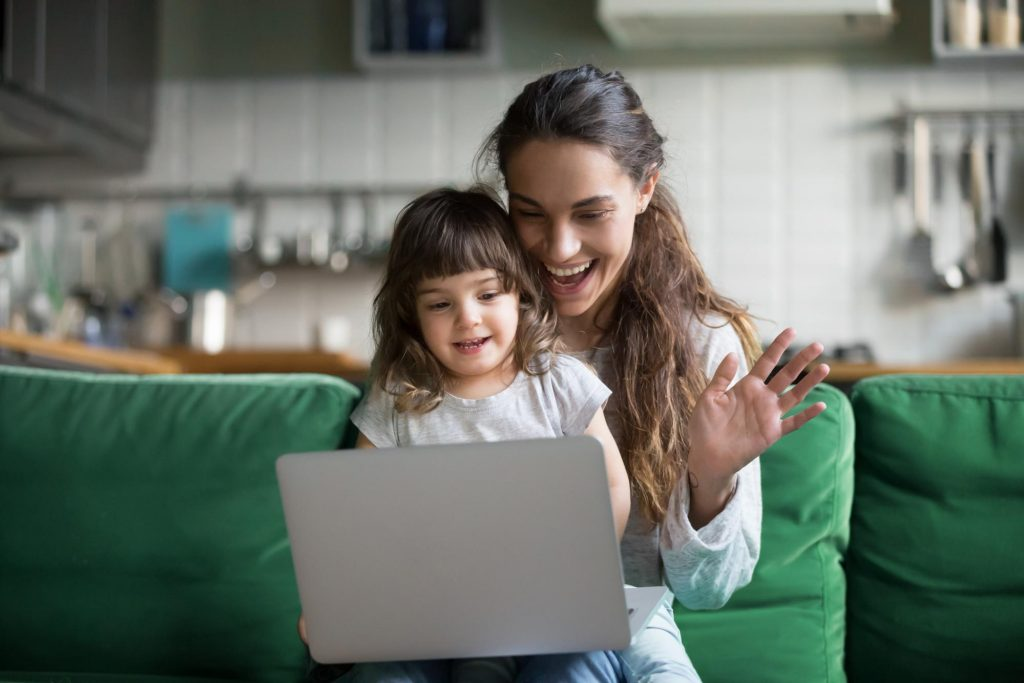 mother using technology for video chatting with young child